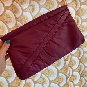 Cute vintage purple leather clutch